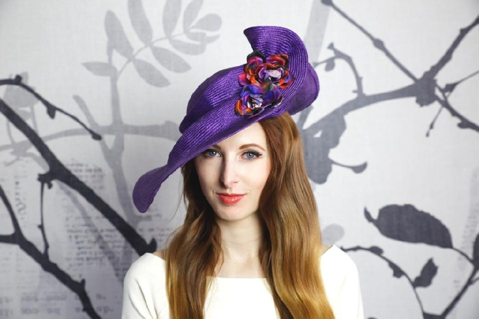 IMAGE - Dark purple parasisal straw hat with handshaped brim and handmade silk flowers, size 55.