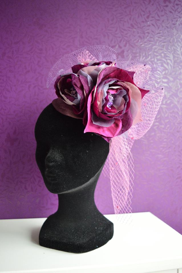 IMAGE - Dark purple sinamay fascinator with pink and purple netting and handmade silk flowers in mixed fabric. These can be made in various colours on request. Fixes to hair with a comb.