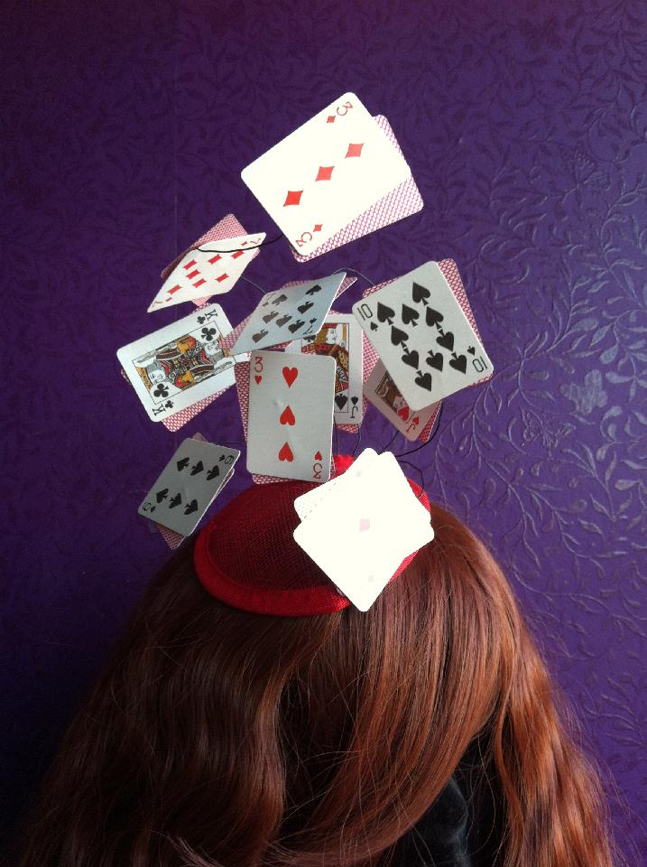 IMAGE - Red sinamay fascinator with mini playing cards on wire. Fixes to hair with a comb.