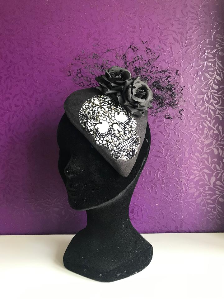IMAGE - Handblocked fascinator coverd with black textured fabric. Decorated with glittered skull appliqué, black flowers and vintage black voillette. Finished with black rhinestones.