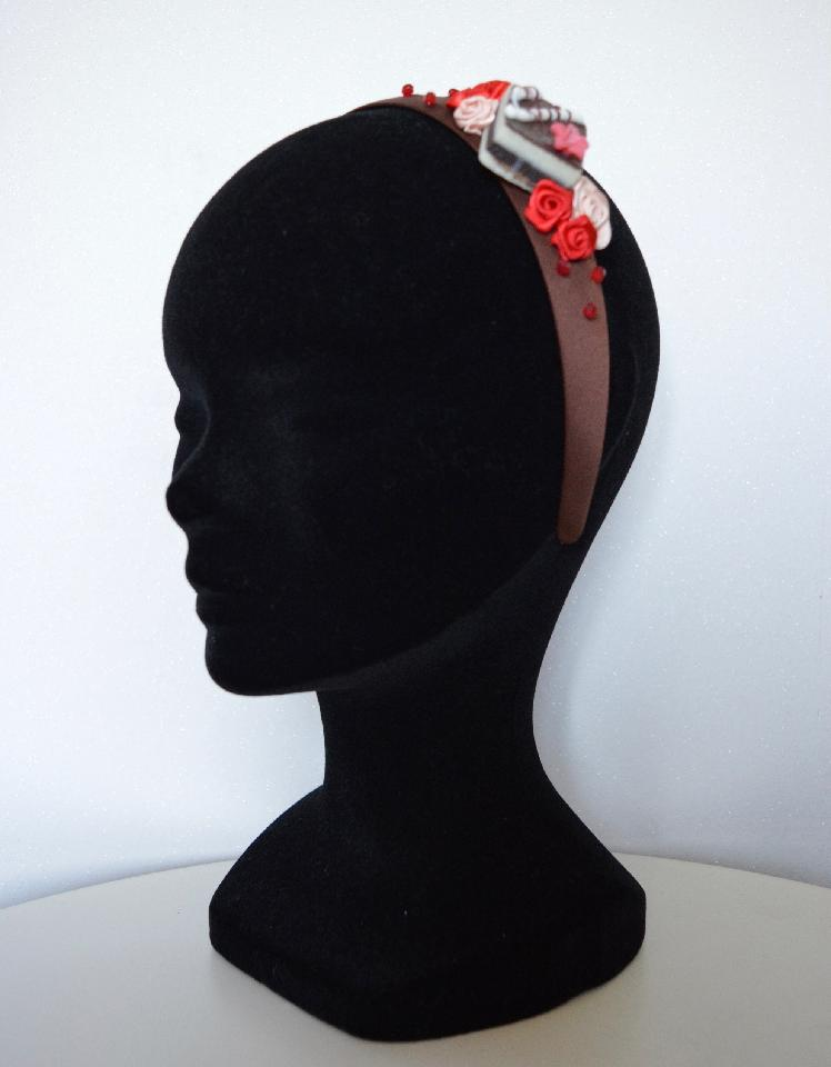 IMAGE - Brown satin headband with cake, red and cream ribbon roses and red beads.