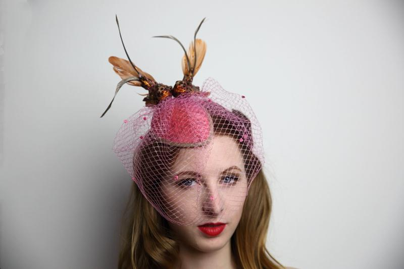 IMAGE - Handblocked pink sinamay fascinator decorated with pink birdcage veil, brown trim and a couple of brown birds. Fixes to the hair with wigclips.