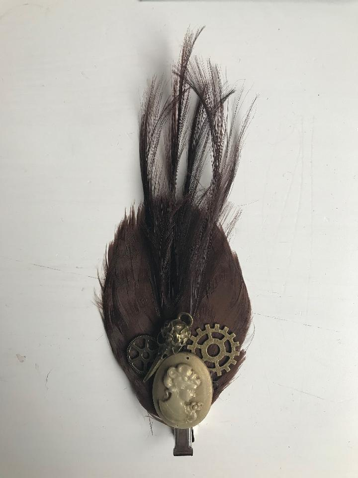 IMAGE - Brown featherpas hairpin with gold cameo, bronze gears and birdskull.
