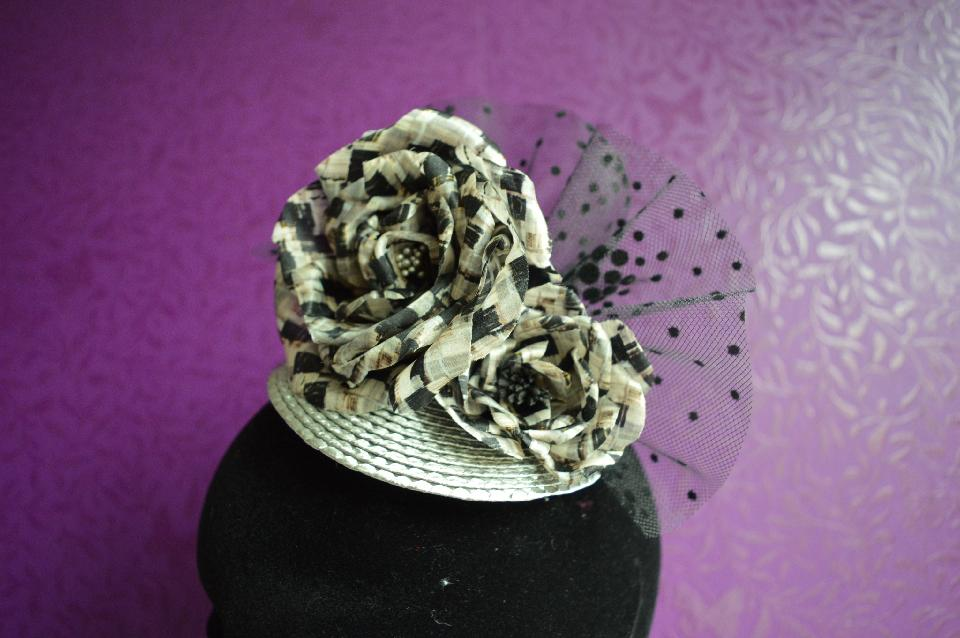 IMAGE - Silver straw fascinator with handmade black and white silk flowers and tulle. Fixes to hair with a comb.