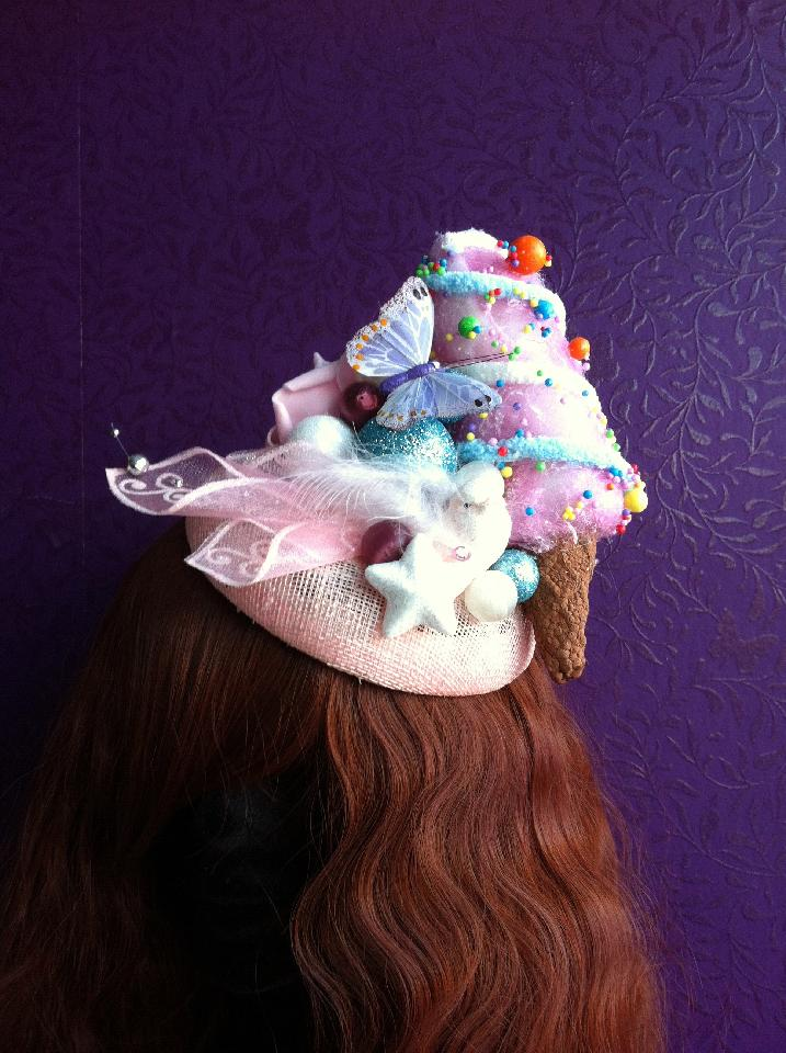 IMAGE -  Pale pink sinamay fascinator decorated with big icecream ornament, pink bird and butterfly. Very lightweight, fixes to hair with a comb.