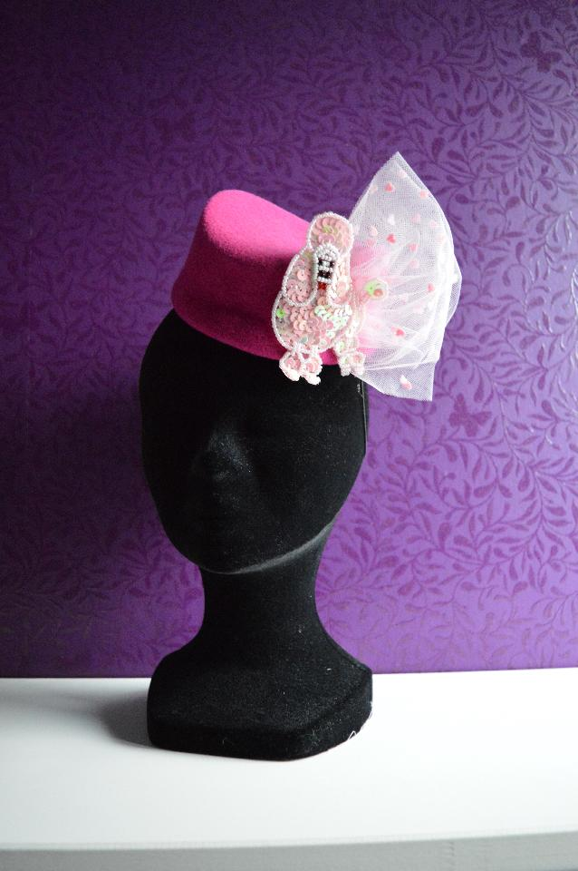 IMAGE - Hand blocked hot pink wool felt hat, decorated with light pink tulle with hearts and paillette poodle. Fixes with an elastic.