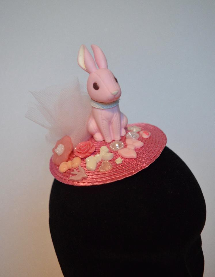 IMAGE - Pink fascinator with light pink tulle, bunny and ornaments. Fixes to hair with a comb.