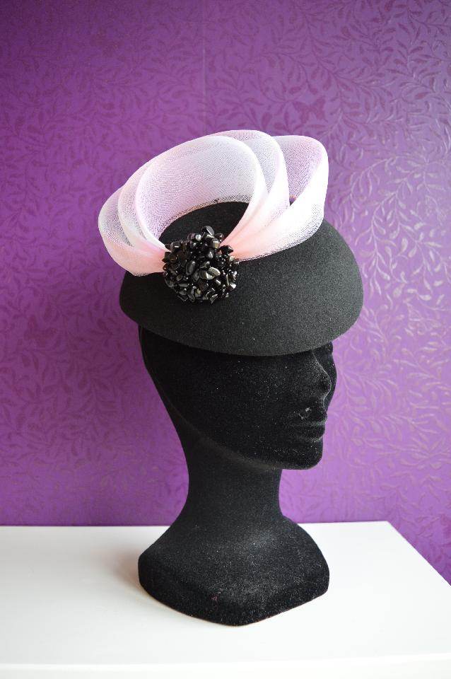 IMAGE - Handblocked black felt fascinator with light pink horsehair crin swirls and black beads. Fixes to hair with an elastic.