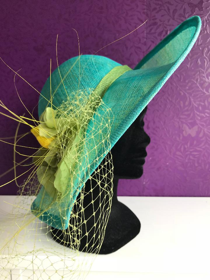 IMAGE - Handblocked sinamay hat, with blue upperlayer and green underneath. 
