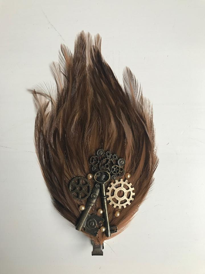 IMAGE - Lightbrown featherpad with bronze gears, keys and cream pearls.