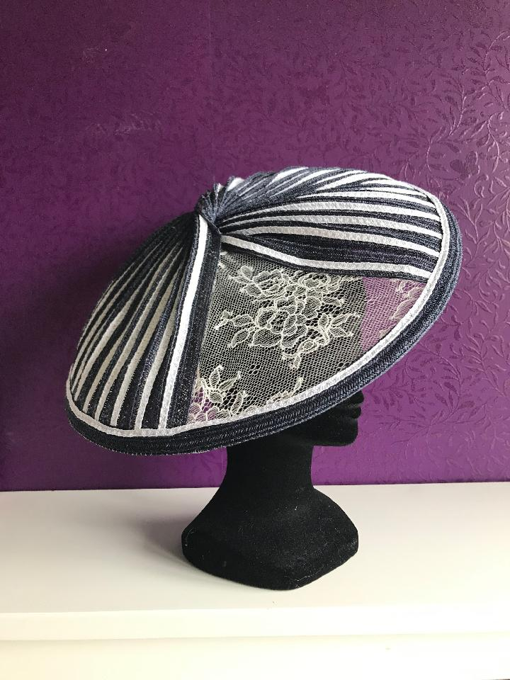 IMAGE - Navy straw fascinator made from individual strips sewn together to from a saucer. 