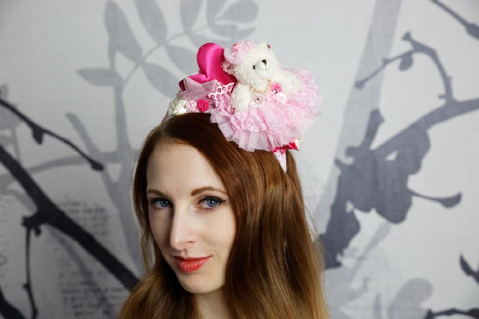 IMAGE - White and pink polkadot headband with bear, heart, stars and roses in different shades of pink and cream. Finished with rhinestones. Mini comb attached for extra support.
