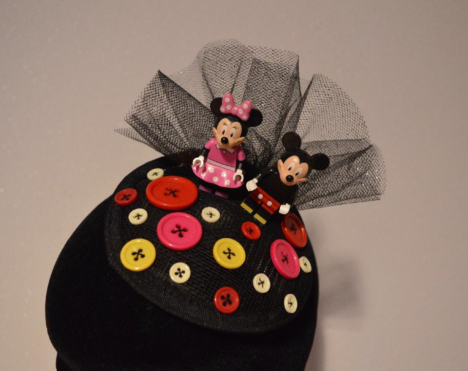 IMAGE - Small black sinamay fascinator with black glittered tulle, Mickey and Minnie and buttons. Fixes to hair with a comb.