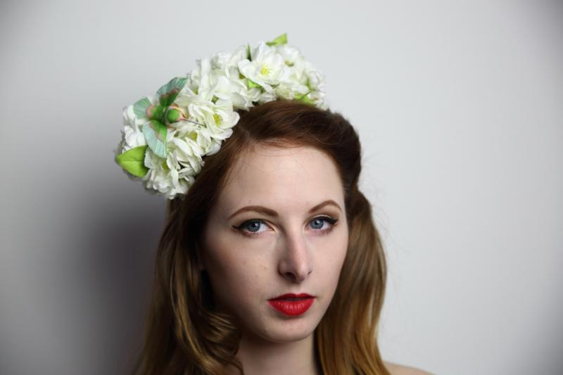 IMAGE - White headband with white flowers and green hummingbird. Mini comb is added for extra support.
