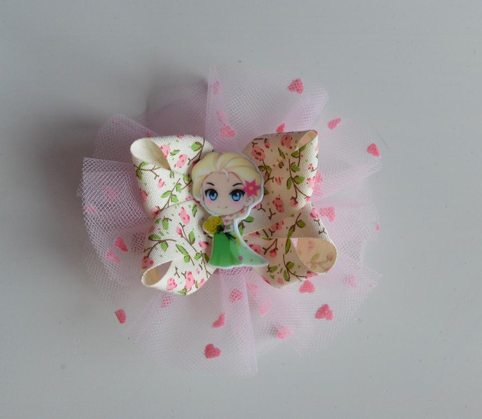 IMAGE - Rosette hairpin in pink with Elsa center. Can be worn as hairpin and broche.