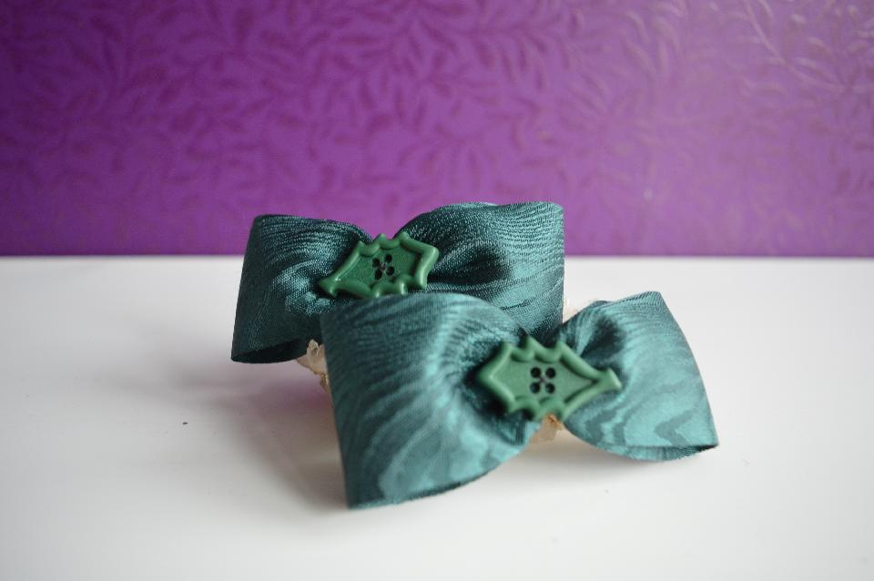 IMAGE - Set of two dark green hairpins with holly leaves.