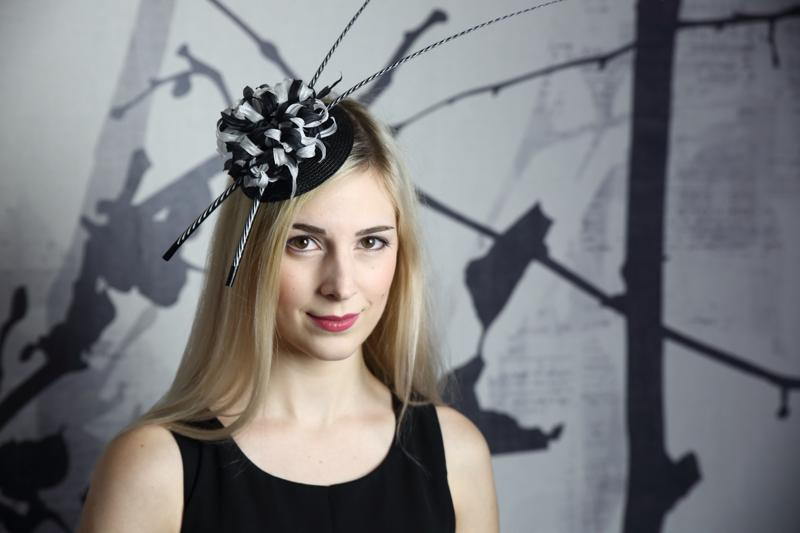 IMAGE - Black straw fascinator with two painted quils and a black and white silk flower.
