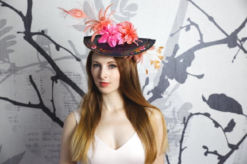 IMAGE - Blue satin headband with small wooden, handpainted fan. Decorated with orange feathers and orange and pink silk flowers.