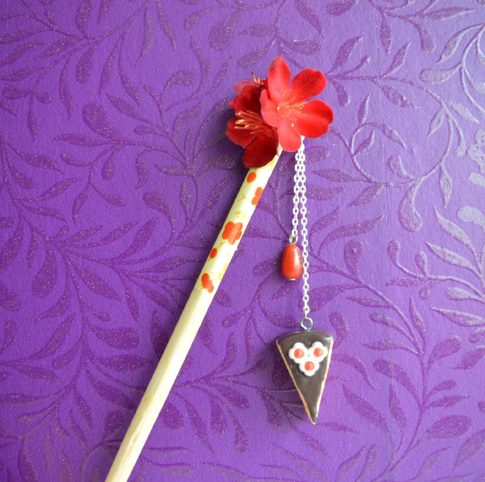 IMAGE - Hairstick with red flowers, red glass bead and hanging piece of cake.