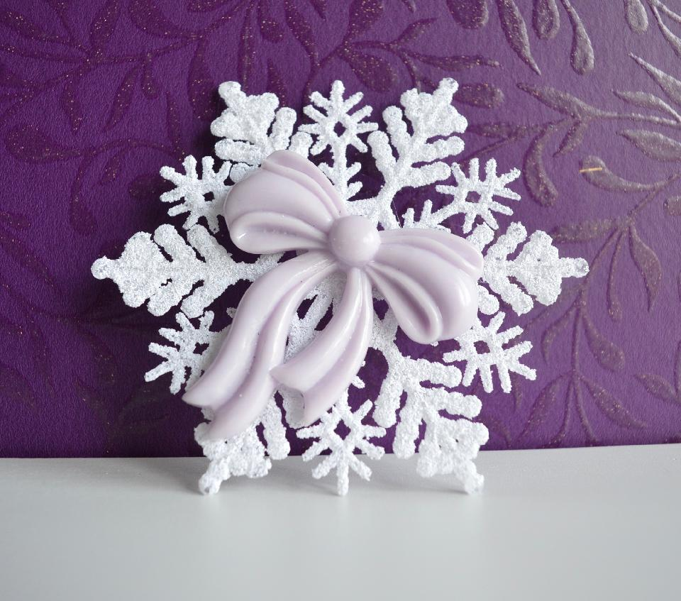 IMAGE - Simple snowflake hairpin with purple bow.