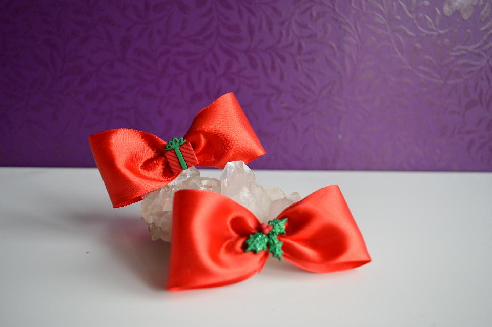 IMAGE - Red satin hairpins with present and glittered holly leaves.