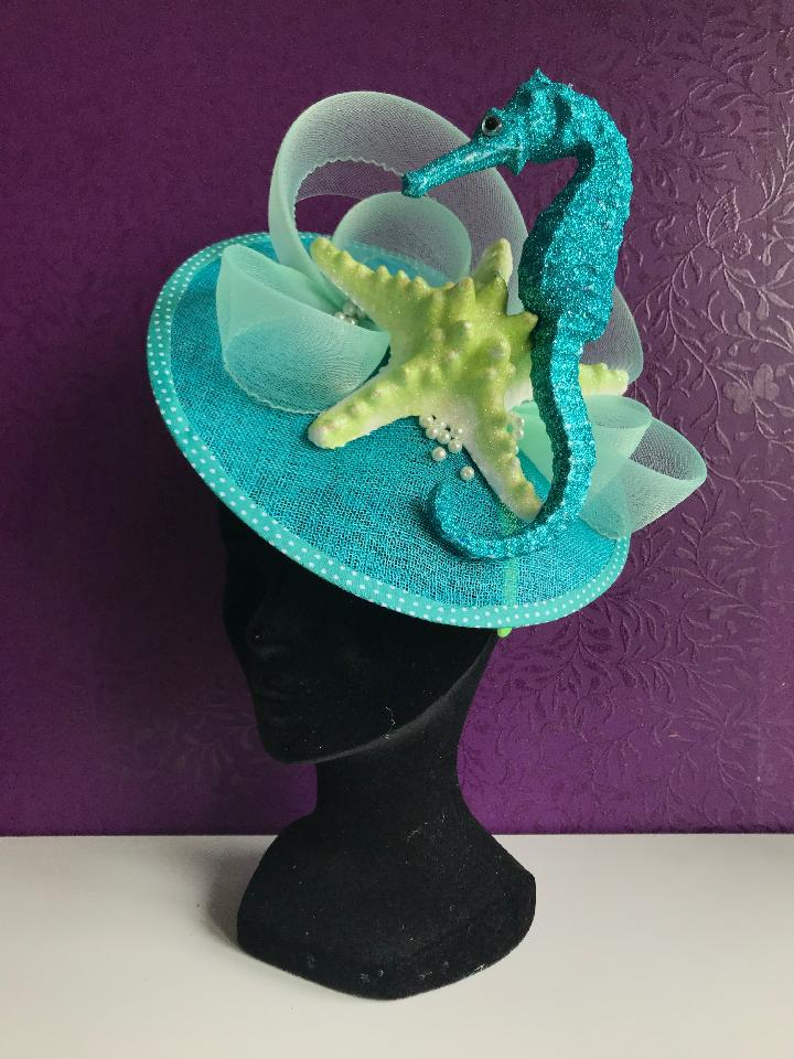 IMAGE - Blue sinamay saucer with glittered seastar and seahorse.