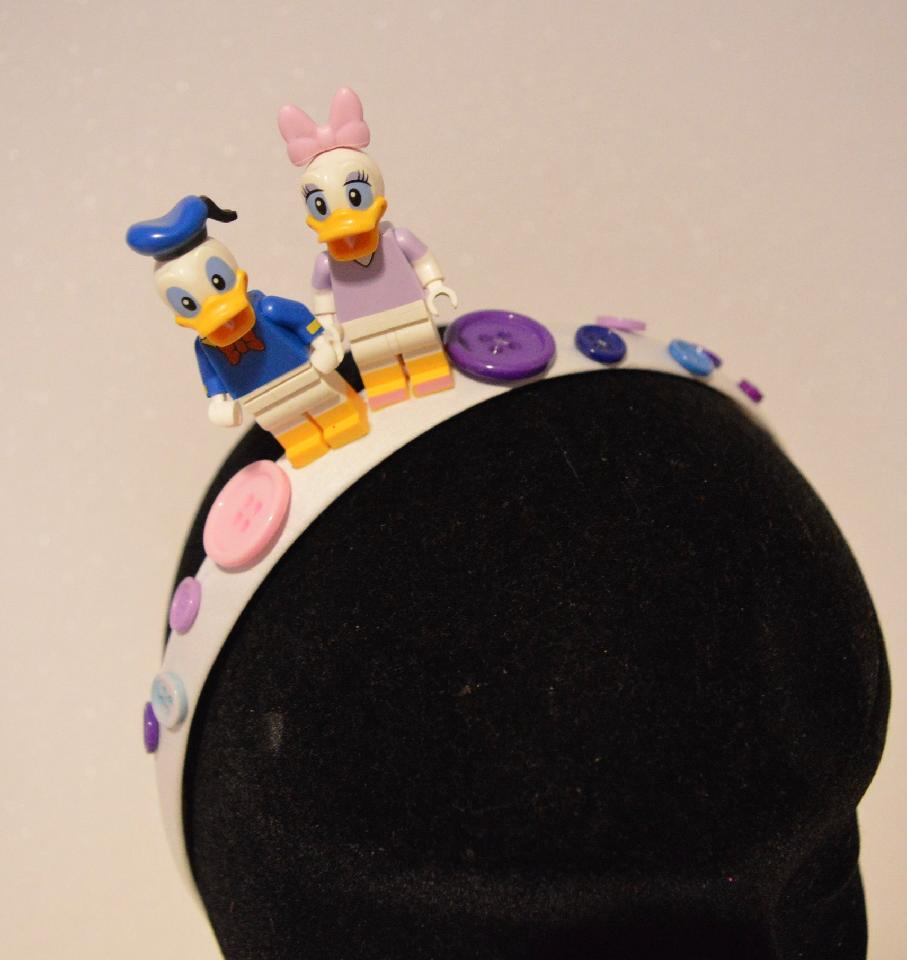 IMAGE - White satin headband with Daisy and Donald duck, decorated with buttons in various colours.