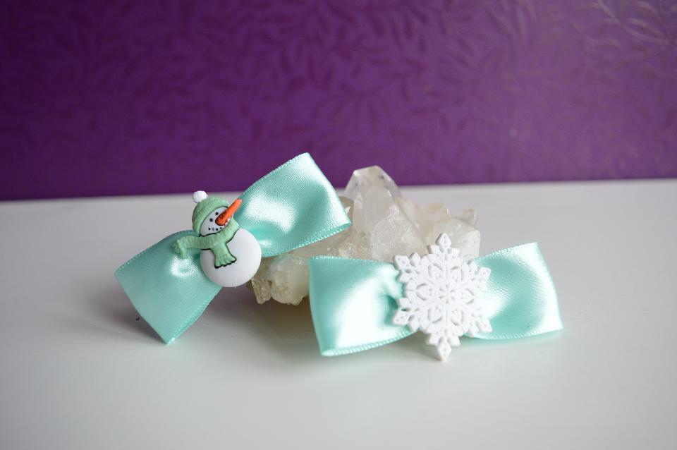 IMAGE - Set of two light blue satin bow hairpins with snowman and snowflake.