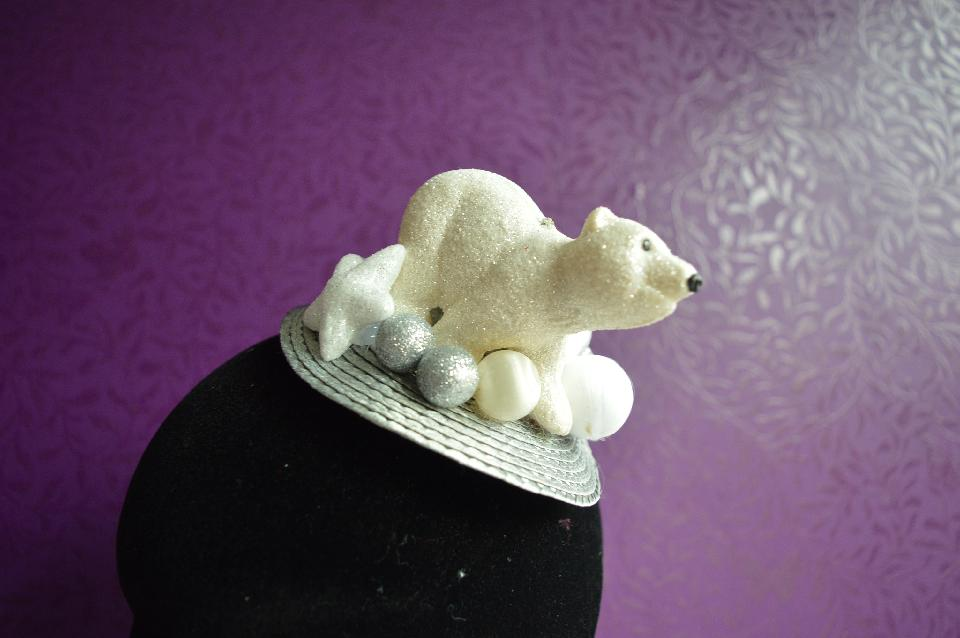 IMAGE - Silver straw fascinator with polarbear and white and silver glittered spheres. Fixes to hair with a comb.