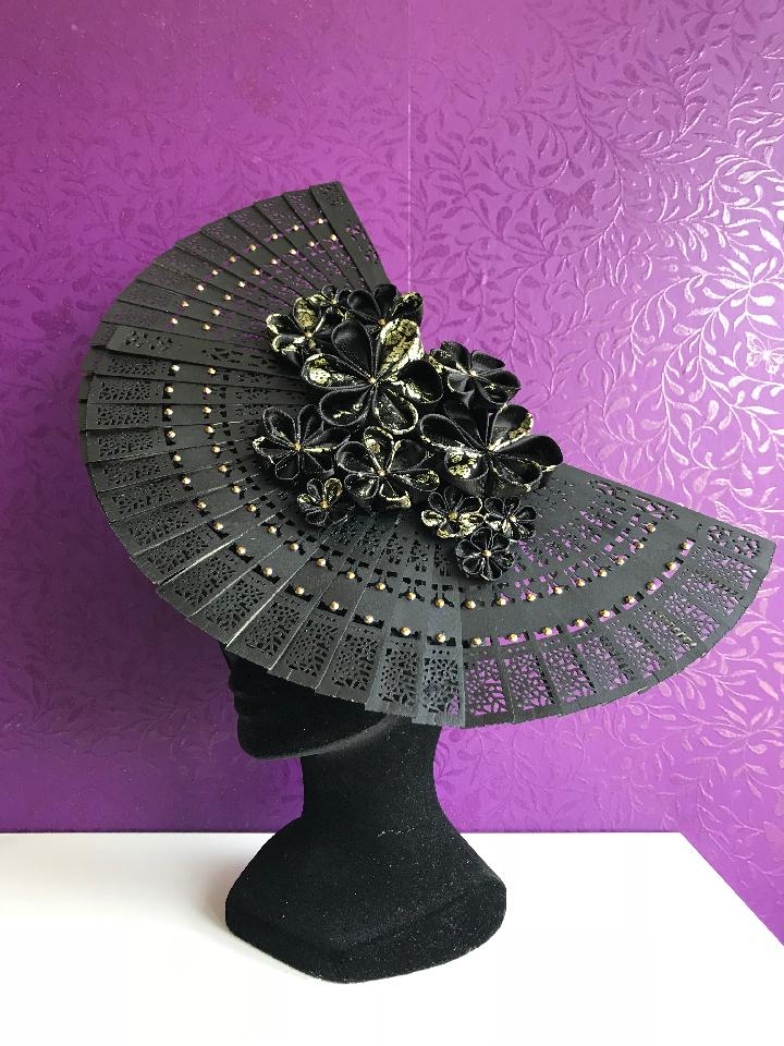 IMAGE - Black satin headband with two black cedarwood fans. Decorated with black and gold handfolded kanzashi flowers and gold rhinestones. Very lightweight, has an extra elastic for comfortable wear.