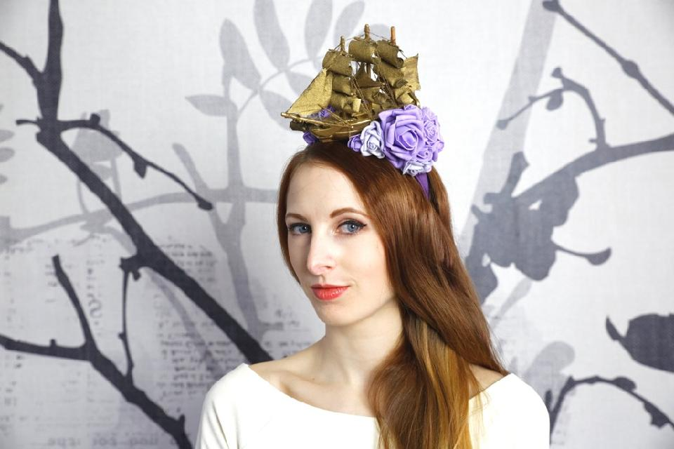 IMAGE - Purple satin headband with golden ship and purple and lilac foam flowers.