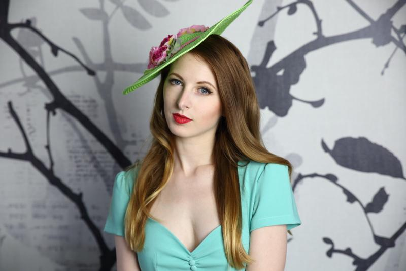 IMAGE - Green straw hat with pink trim and flowers. 