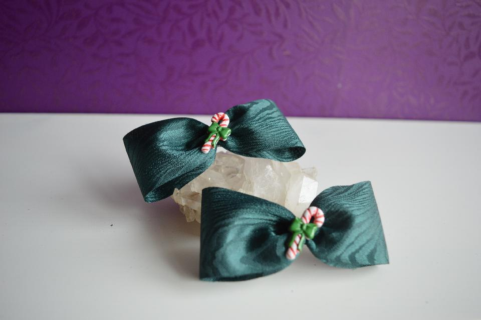 IMAGE - Set of two dark green hairpins with candy canes.