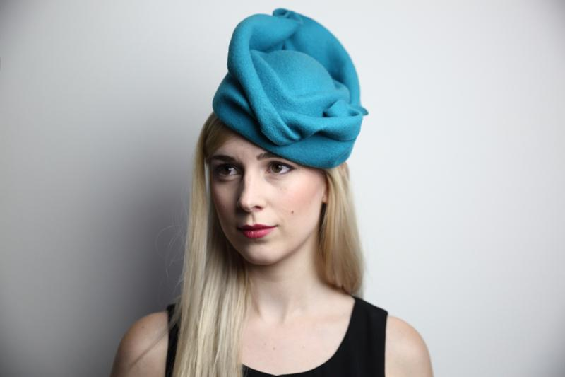 IMAGE - Handblocked teal woolfelt hat with handshaped brim. 