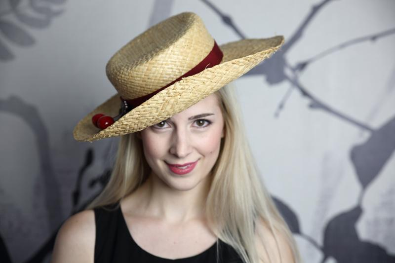 IMAGE - Hand blocked straw hat with dark red ribbon and cherry decoration.