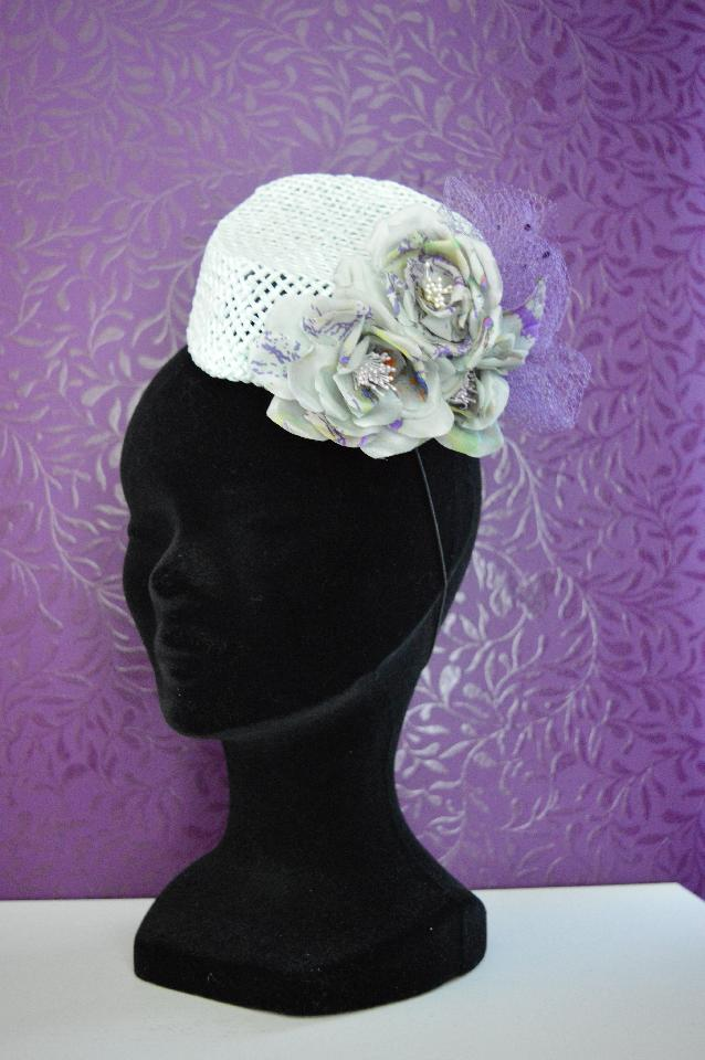 IMAGE - Handblocked mint straw fascinator, decorated with purple net and handmade silk flowers. Fixes with an elastic and extra wig clip.